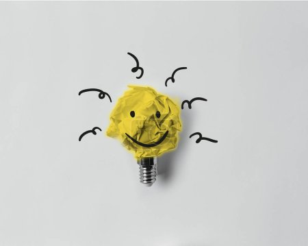 Photo for Top view of crumpled paper as light bulb with smile - Royalty Free Image