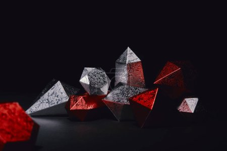 Photo for Close-up view of shiny faceted red and silver gemstones on black - Royalty Free Image
