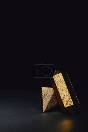 glittering faceted pieces of gold on black background
