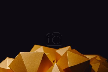 close-up view of faceted golden nuggets isolated on black background
