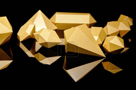 Photo for Close-up view of shiny faceted golden nuggets reflected on black - Royalty Free Image