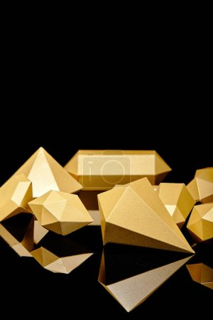 Photo for Shiny faceted golden nuggets reflected on black - Royalty Free Image