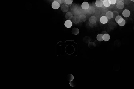 abstract dark background with silver silver bokeh