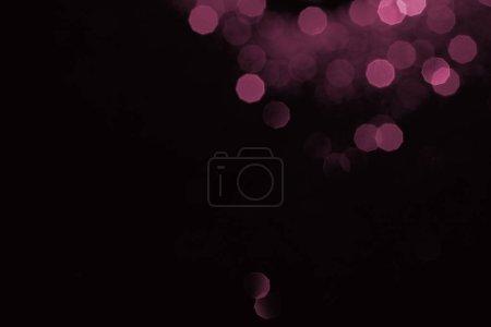 abstrait fond sombre avec bokeh rose