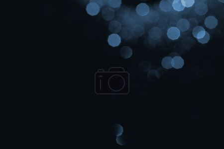 abstract dark background with blue bokeh