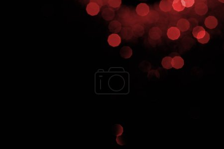 abstract dark background with red bokeh