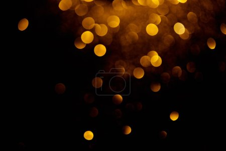 Photo for Golden decorative bokeh on black background - Royalty Free Image