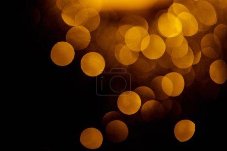 Photo pour Bokeh doré sur fond festif noir - image libre de droit