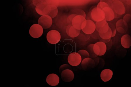 red bokeh on black festive background