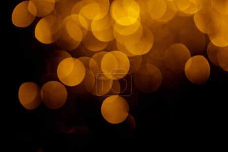 gold festive bokeh on black background for holiday