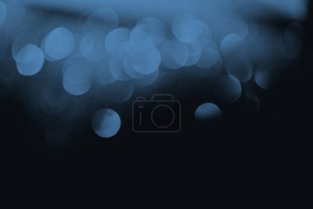 Photo for Festive blue bokeh on black background with copy space - Royalty Free Image