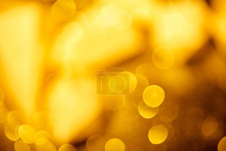 golden festive bokeh on black background
