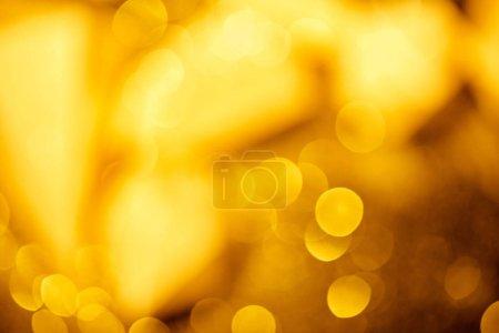 Photo for Golden festive bokeh on black background - Royalty Free Image