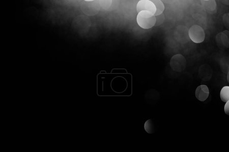 Photo for Sparking silver bokeh on black background for celebration - Royalty Free Image