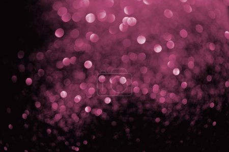 abstract background with blurred glowing pink glitter