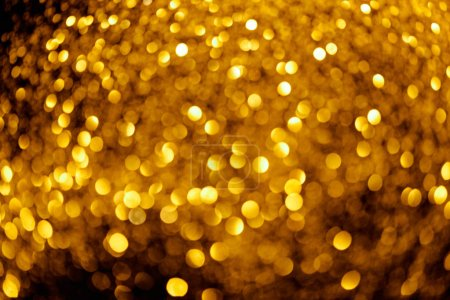 abstract background with blurred gold glitter