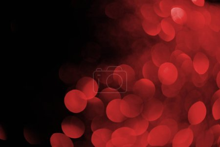 red bokeh on black background for holiday