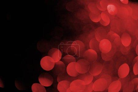 Photo pour Bokeh rouge sur fond noir pour les vacances - image libre de droit