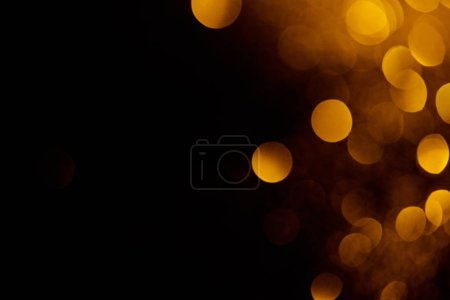 Photo for Abstract dark background with beautiful gold bokeh and copy space - Royalty Free Image