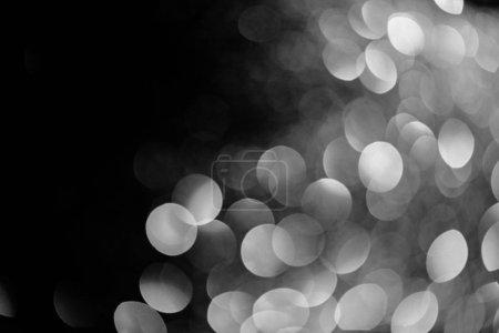 Photo pour Argent brillant bokeh sur fond noir pour les vacances - image libre de droit