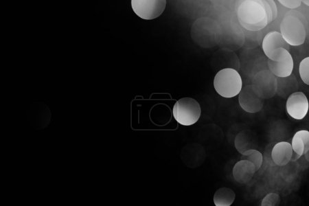abstract dark background with beautiful sparking silver bokeh