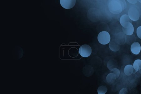 Photo for Blue bokeh on black background for holiday - Royalty Free Image