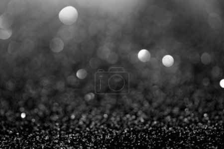 abstract background with shiny silver glitter and bokeh