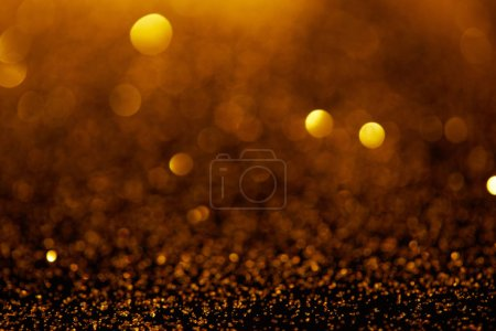 abstract background with gold glitter and bokeh