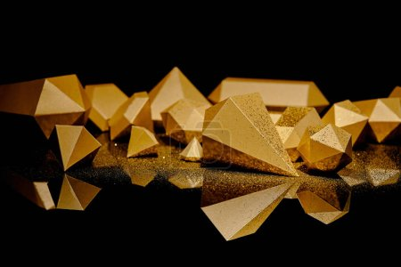 Photo for Close-up view of shiny golden glittering pieces of gold reflected on black - Royalty Free Image