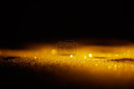 abstract shiny gold glitter on dark background