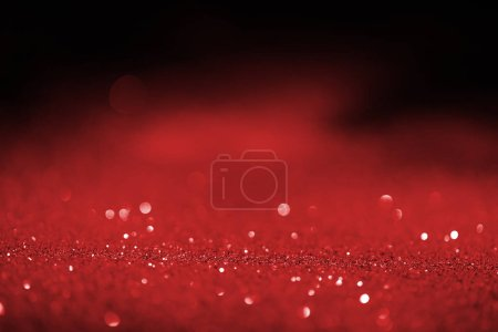 abstract blurred red glitter on dark background