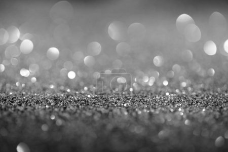 abstract background with glowing silver glitter and bokeh