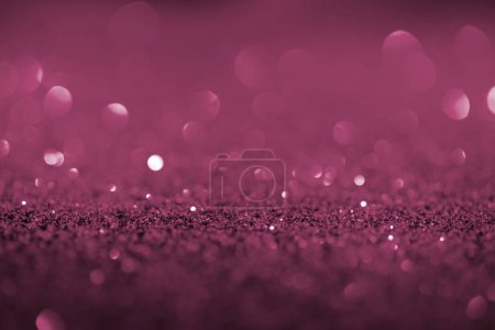abstract background with purple glitter and bokeh