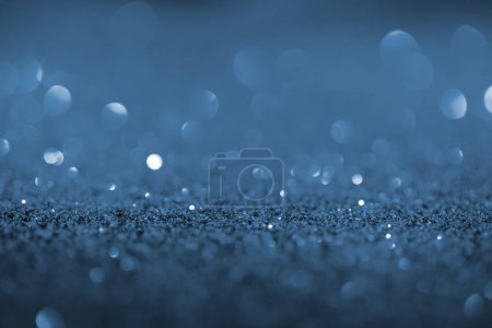 abstract beautiful background with blue glitter and bokeh