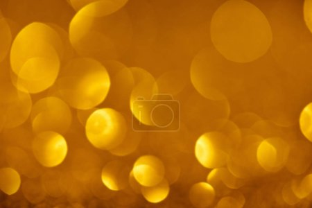 abstract blurred gold texture with copy space
