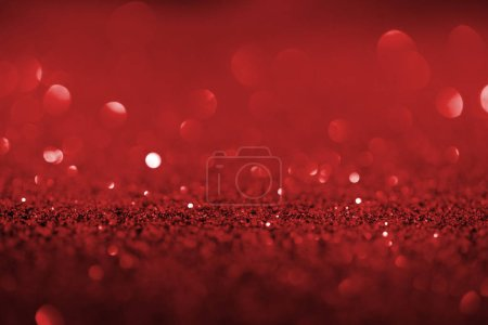 abstract background with red glitter and bokeh