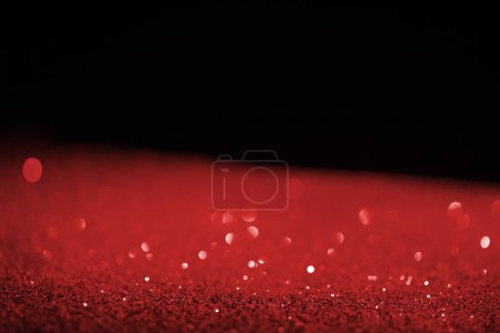blurred red glowing glitter on black background