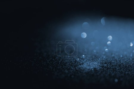 blurred blue glitter on dark background