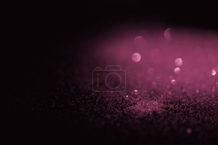 blurred pink glitter on dark background