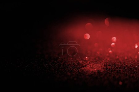 blurred red glitter on dark background