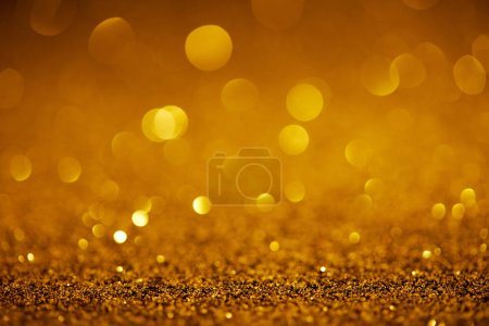 abstract golden glitter with bokeh on background