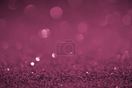abstract purple glitter with bokeh on background