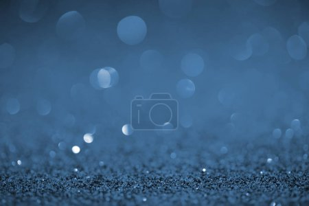 abstract background with blue glitter and bokeh