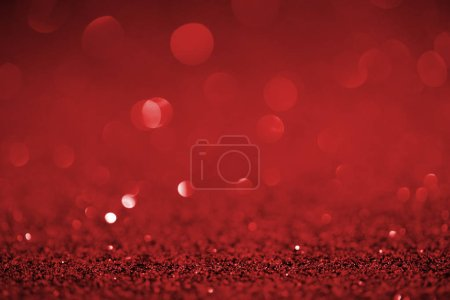 abstract red glitter with bokeh on background