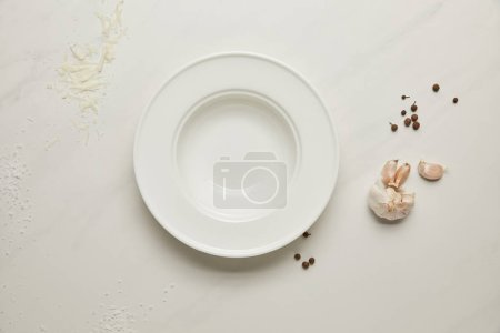 Photo for Flat lay with arranged flour, grated cheese, garlic and empty plate on white tabletop - Royalty Free Image