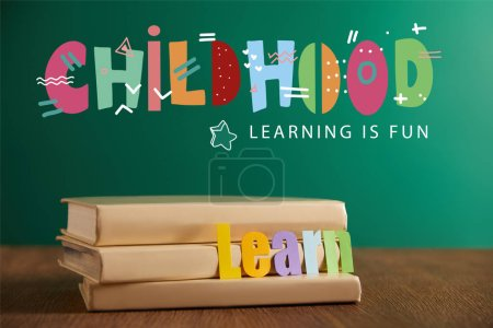 """books with learn sign, chalkboard on background with """"childhood - lettering in fun"""" lettering"""
