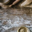 Top view of messy rustic wooden table with spilled...