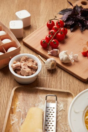 close-up shot of various pasta ingredients on wooden table