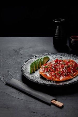 close-up view of delicious traditional Japanese savory pancake Okonomiyaki