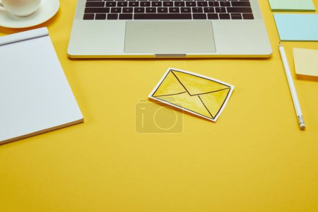 Photo for Paper stickers, message sign and laptop on yellow surface - Royalty Free Image
